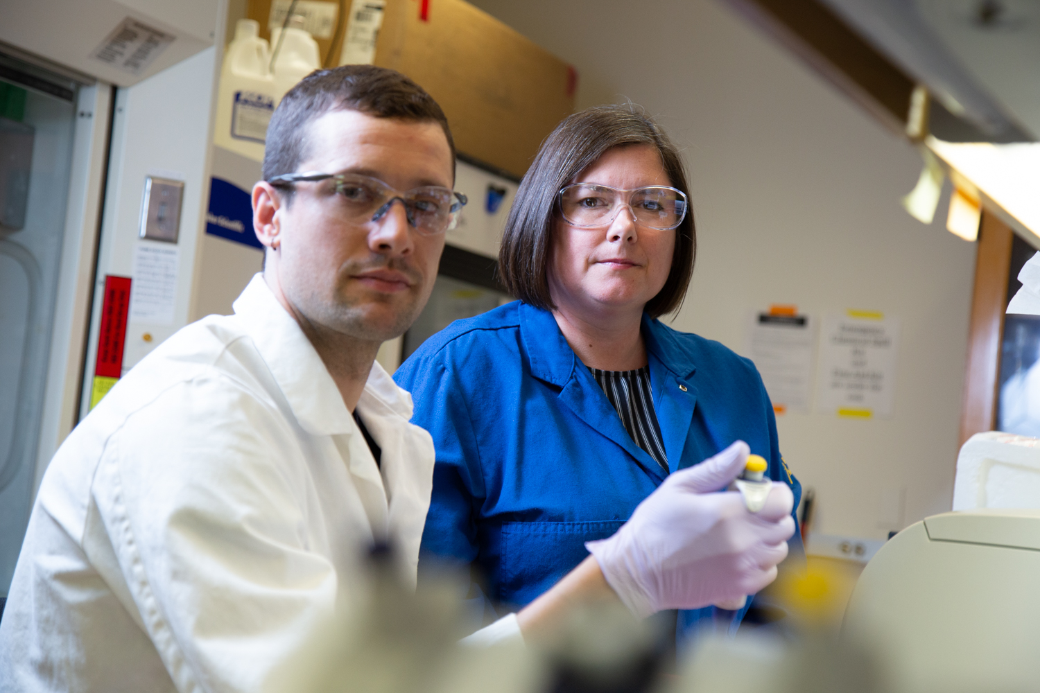 Picture of karen in her lab with a phd student