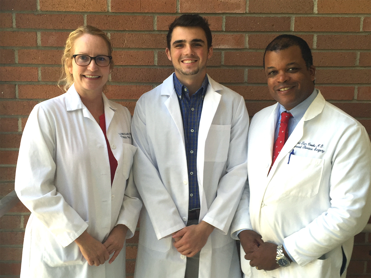 Connor Grant (middle) stands with a couple of his mentors from UC Davis Health.